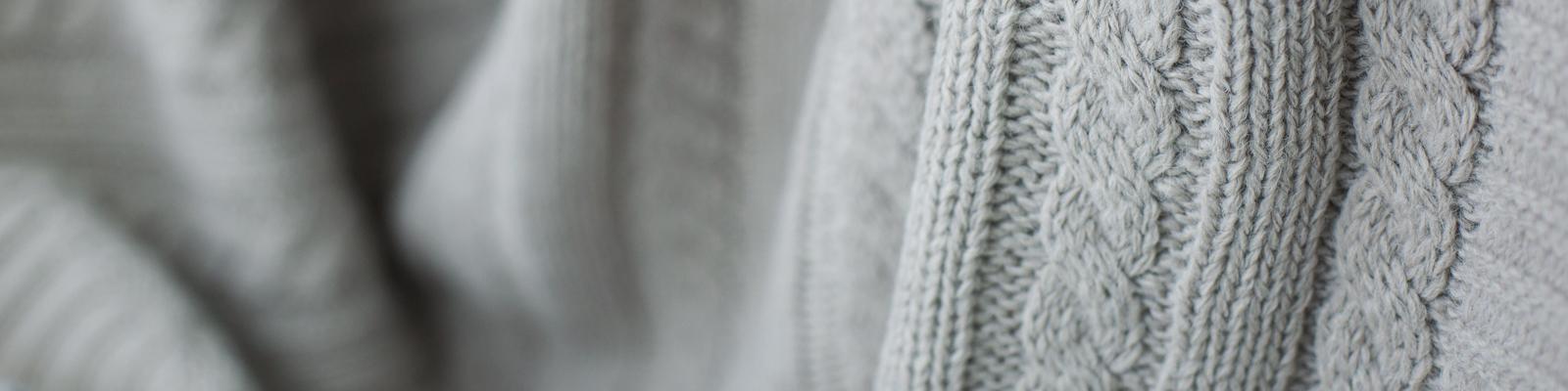 Grey sweater - Mobile Hero Banner. Amica senior living residence.