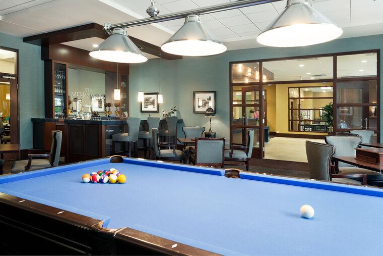 Billiard table in pub at Amica Riverside senior living residence.