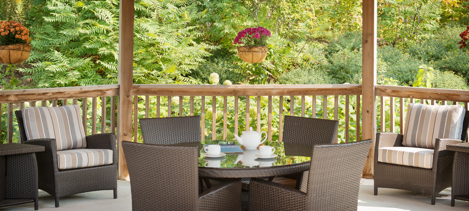 Outdoor terrace with tea set at Amica Little Lake senior living residence.