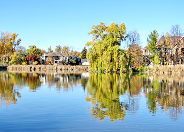 Lake view in park at Amica Thornhill senior living residence.