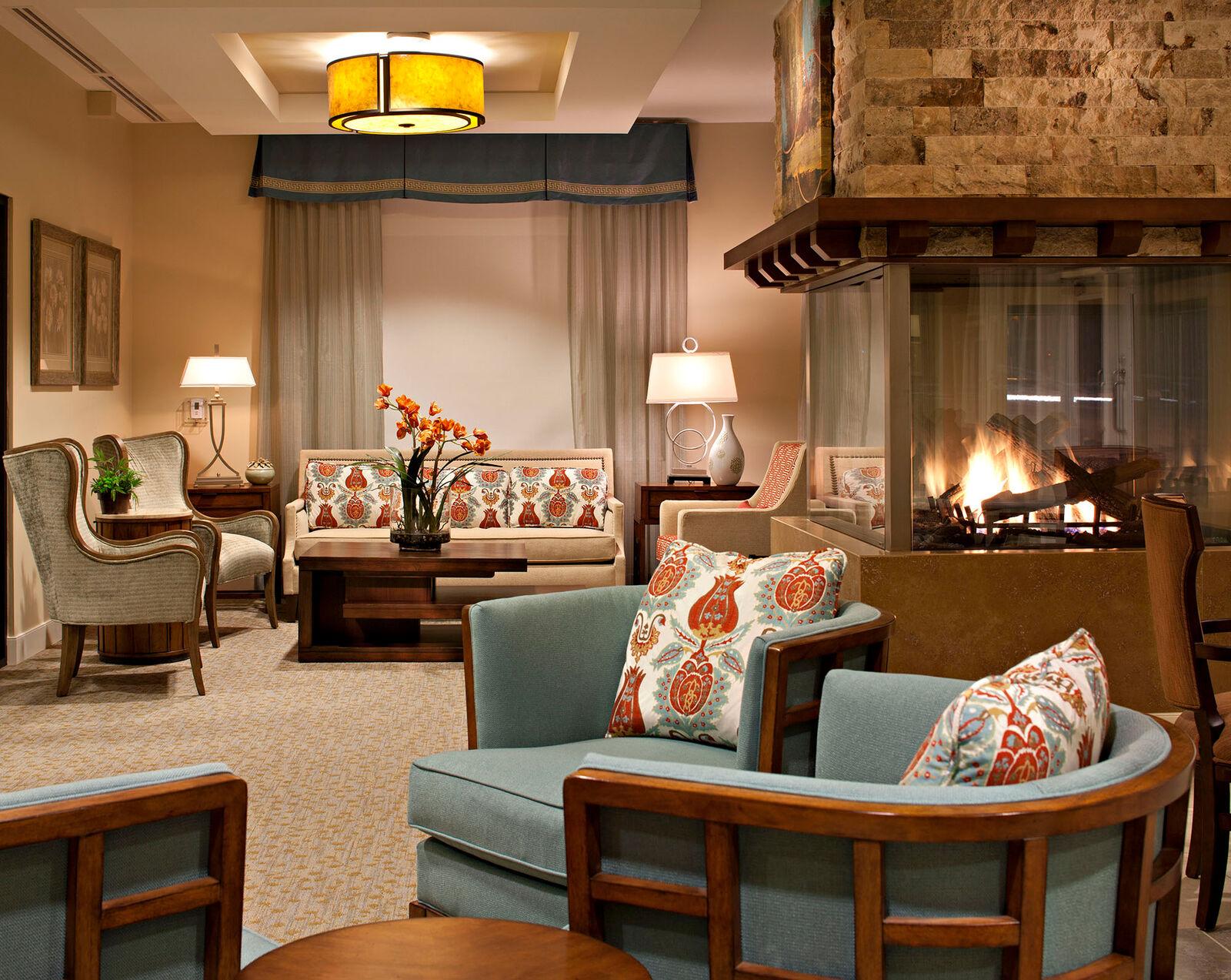 Fireside lounge at Amica Britannia senior retirement residence.