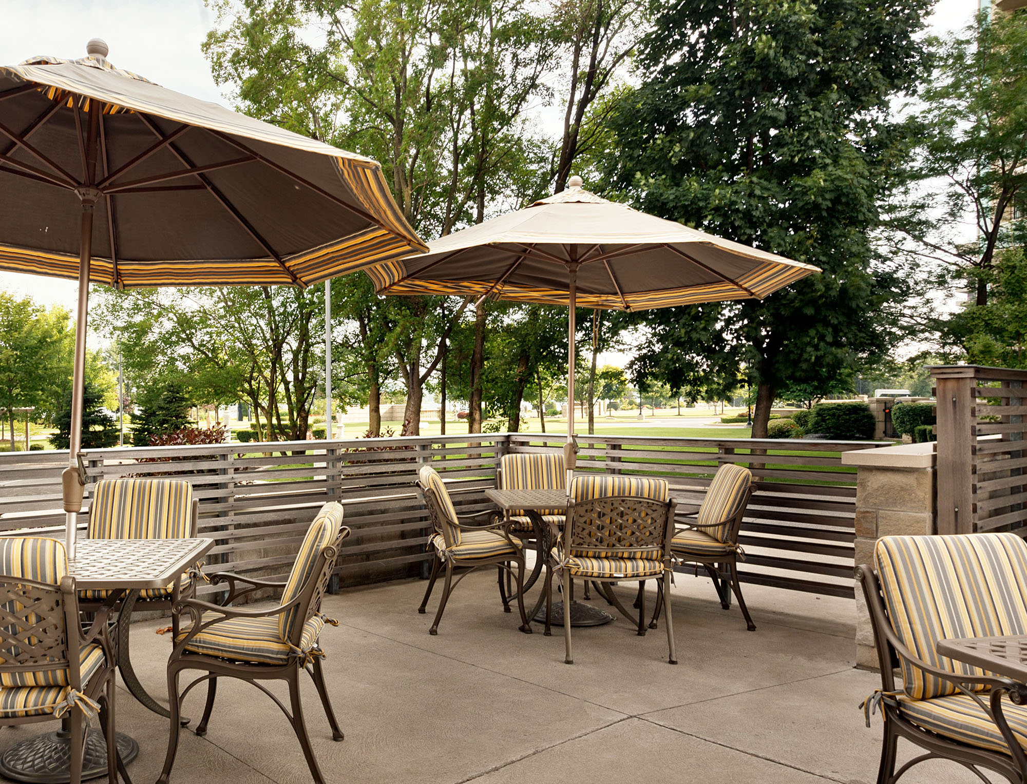 Amica Riverside senior living residence outdoor patio.