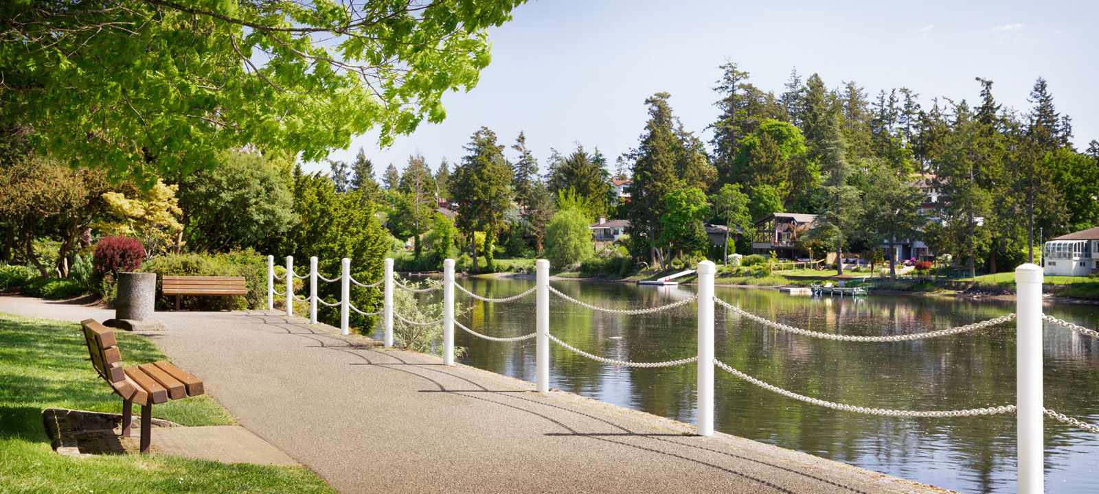 Park with lake view at Amica On the Gorge senior living residence.