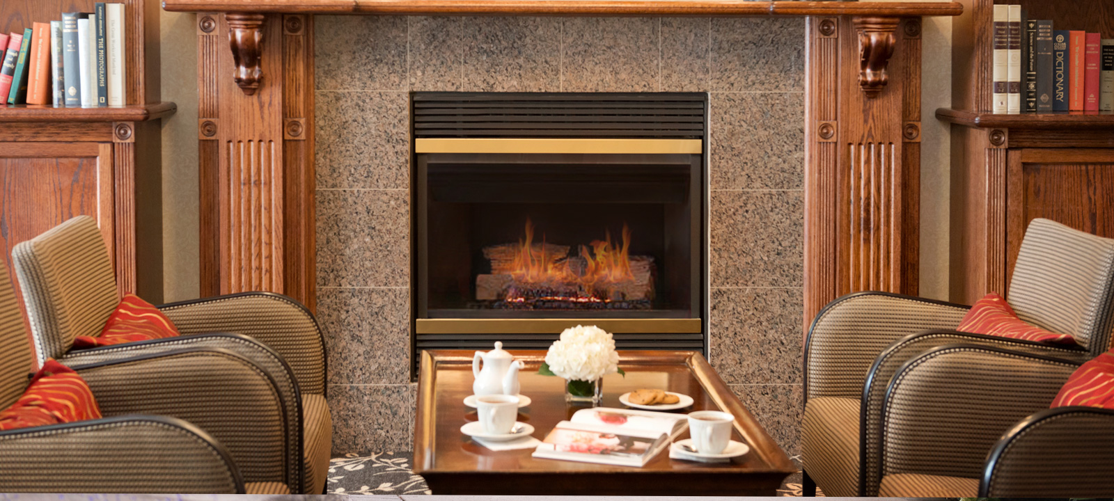 Fireplace lounge at Amica Bayview Village senior retirement residence.