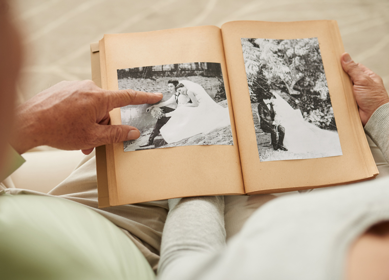 Amica residents looking at old photo album.