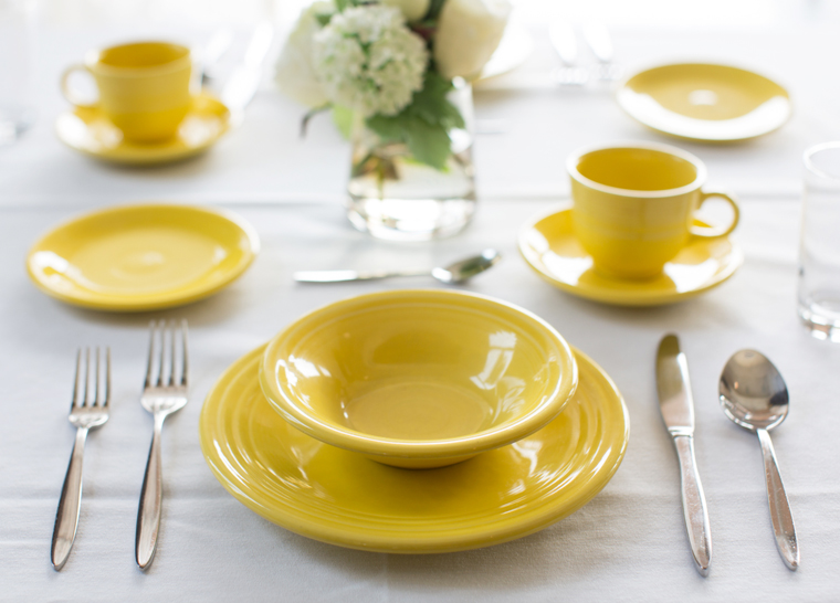 Yellow dining table set at Amica senior living residence.