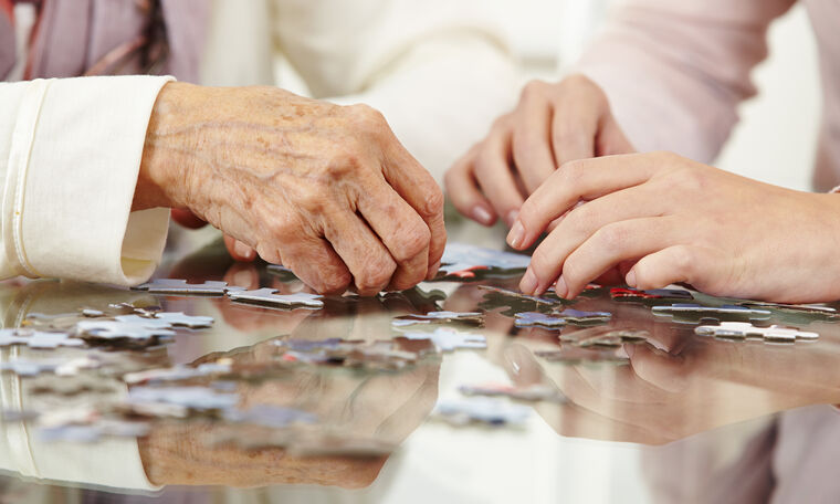 Image for Conversations Article Know common forms of dementia in seniors. Amica seniors playing puzzle.
