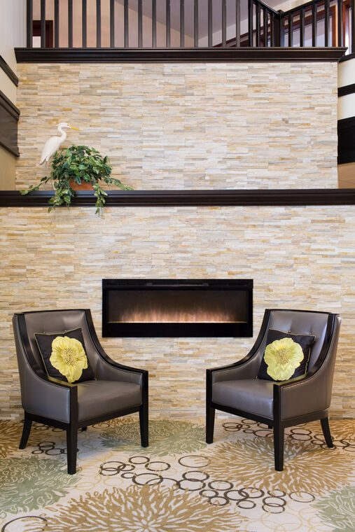 Lobby with fireplace at Amica Beechwood Village senior living residence.