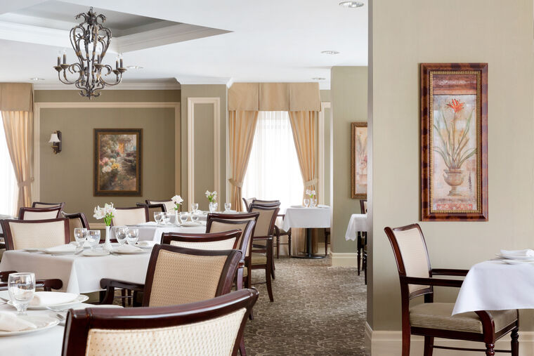 Main dining room at Amica City Center senior living residence.