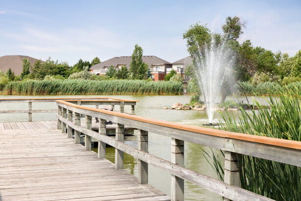 Walkway by Swan Lake at Amica Swan Lake