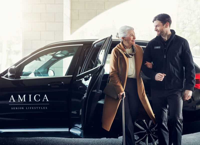 Female resident exiting Amica town car with support of male driver