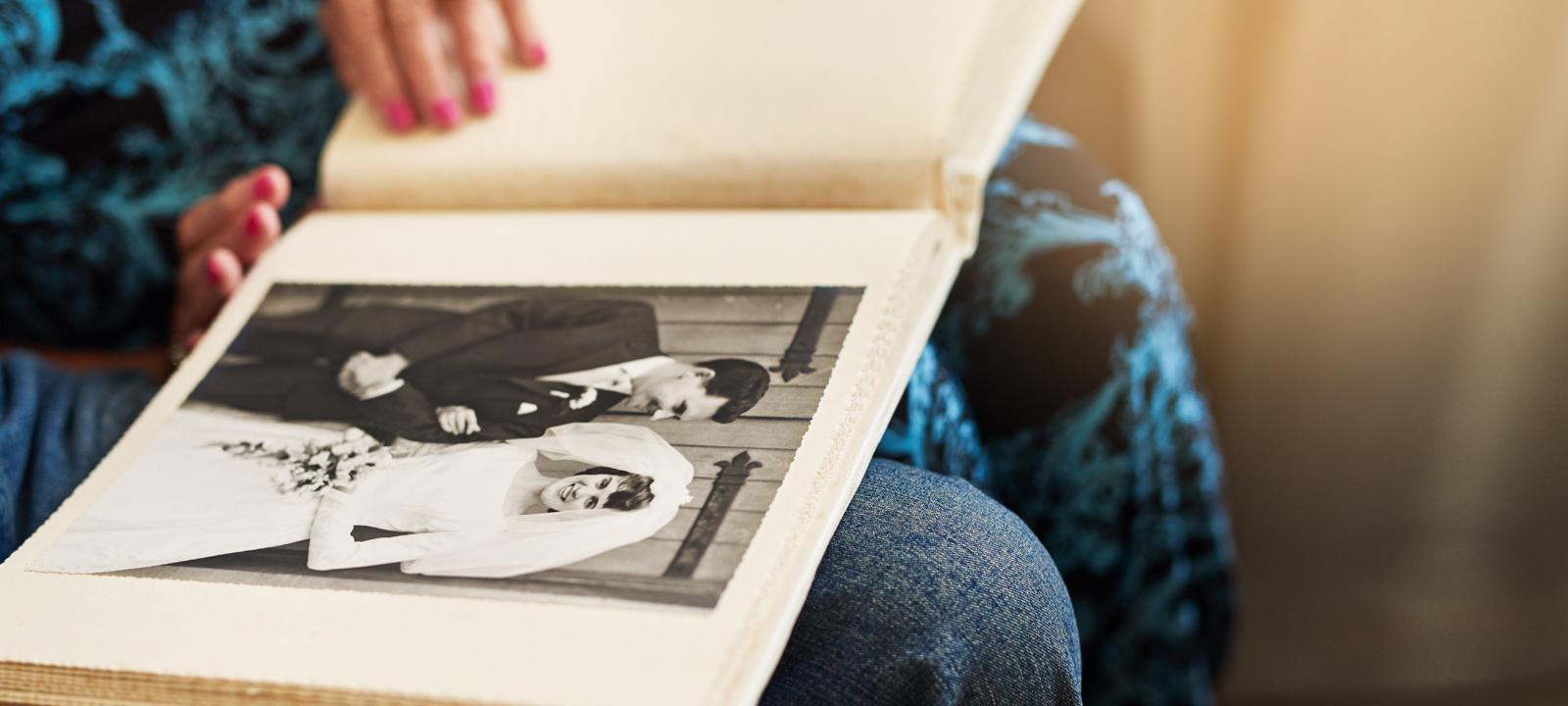 Senior couple looking through their wedding photo album