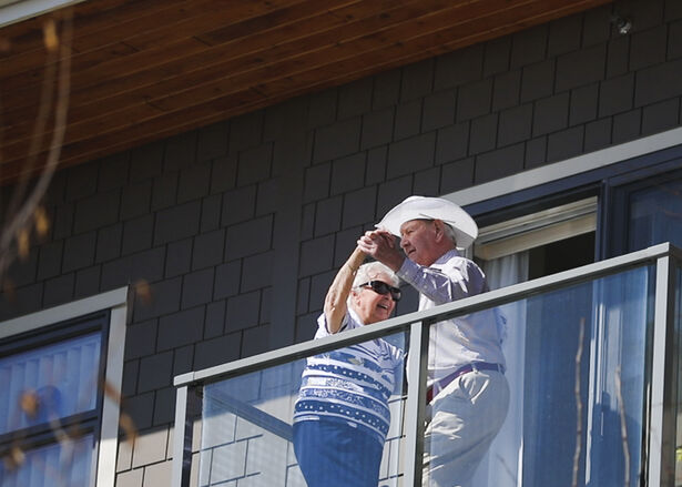 Residents dancing on their balcony