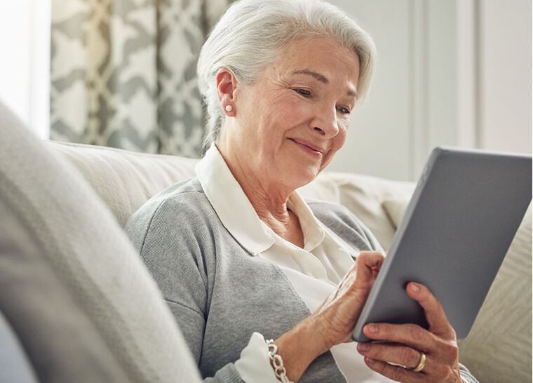 Woman reading on a tablet