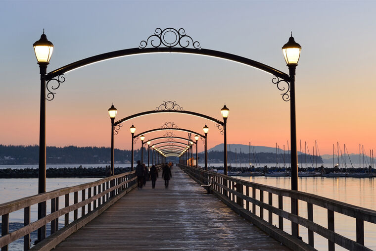 Sunset by the pier at Amica White Rock senior living residence.