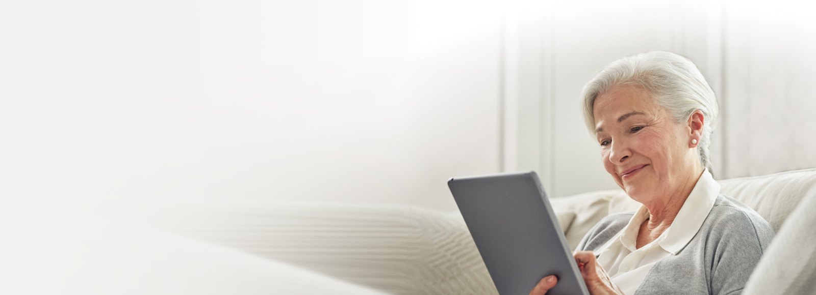 Senior woman using an iPad