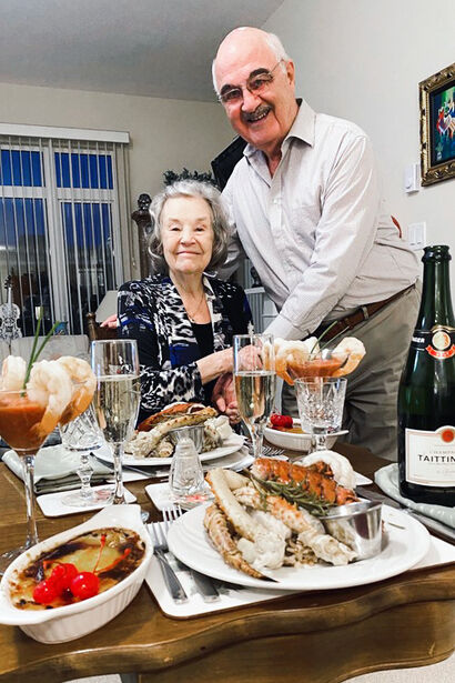 Amica residents celebrating an anniversary with a romantic seafood supper.