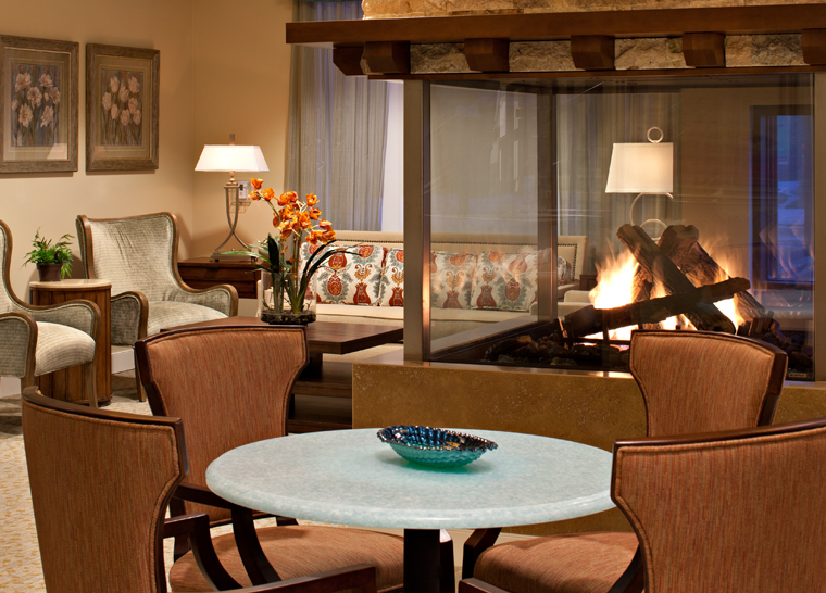 Amica Britannia senior living residence fireplace and lounge.