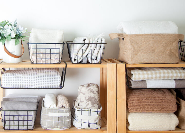 Blankets and towels home supplies organized neatly with organizers and containers