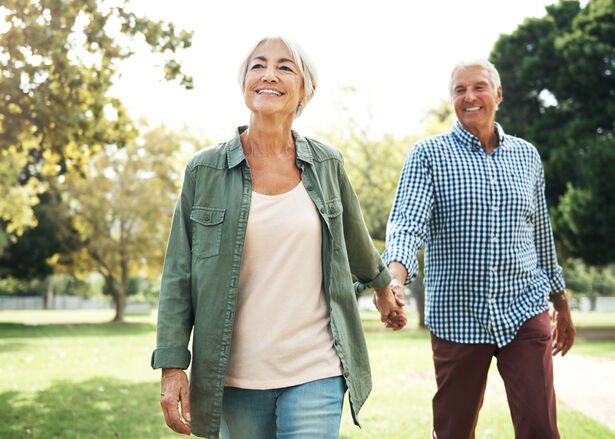 Shot of a happy senior couple going for a walk in the park