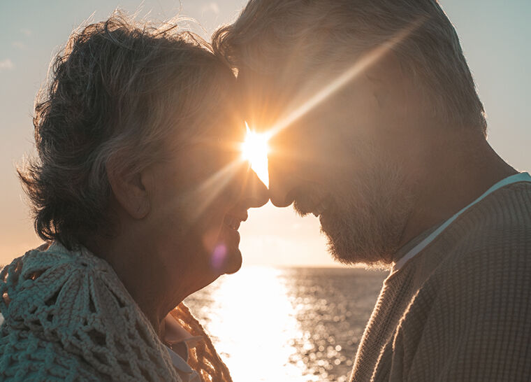 Senior Couple Passionately Engaging and Smiling in the Sunset