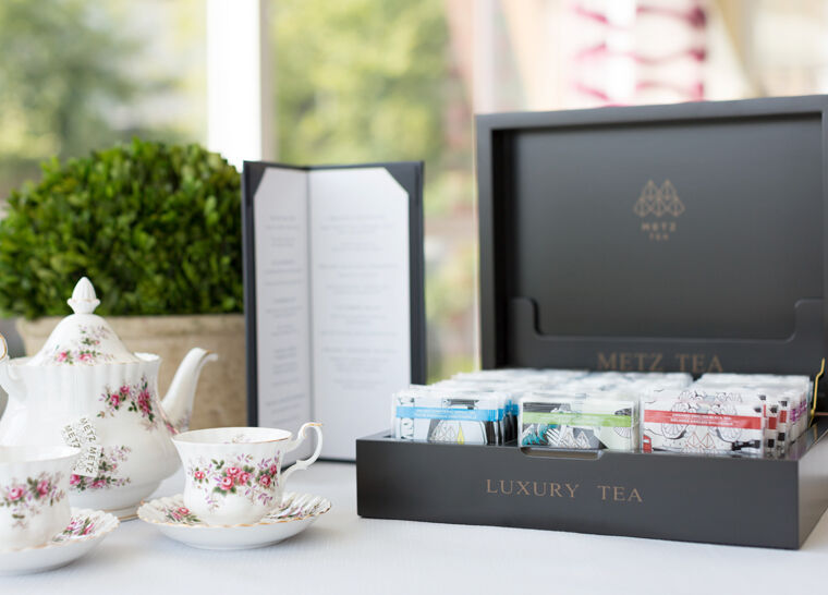 Metz tea box displayed beside tea set
