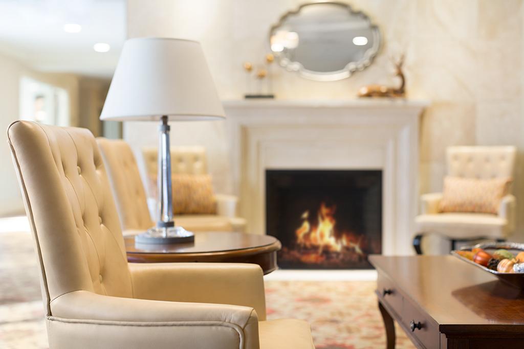 Fireplace lounge at Amica Aspen Wood senior living residence.