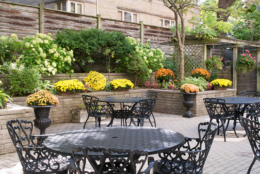 Outdoor patio garden at Amica Balmoral Club senior living residence.