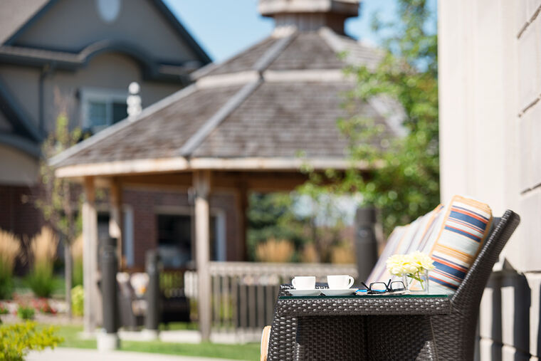 Amica Stoney Creek senior living residence outdoor seating area with gazebo.