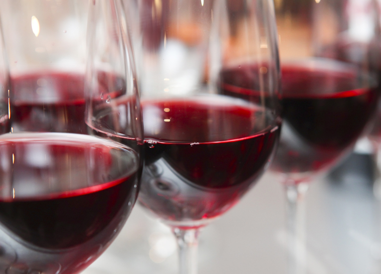 Close up photo of red wine glasses at Amica senior living residence.