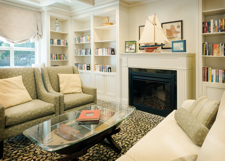 Amica Dundas senior living residence library with fireplace.